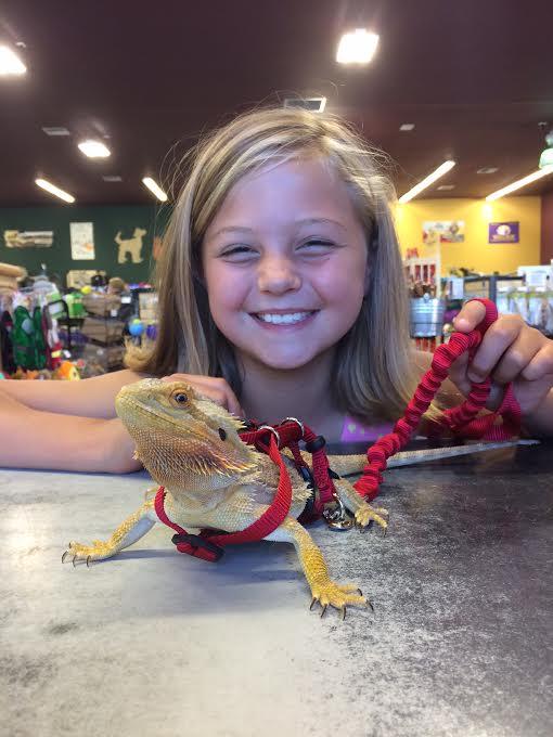 girl and pet lizard